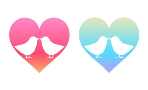小鳥のつがいイラスト ピンクとブルーのハートマークに向き合う二羽の小鳥が白抜きされている
