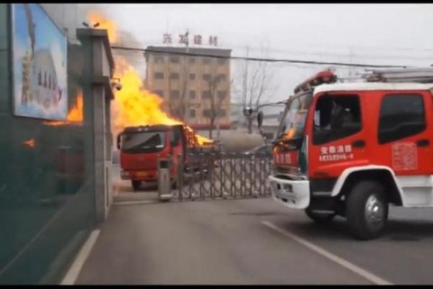 Flaming-truck-driven-to-front-door-of-Chinese-fire-station
