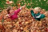 kids-playing-with-autumn-leaves  small