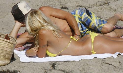 Pamela Anderson - the beach with yellow bikini 03
