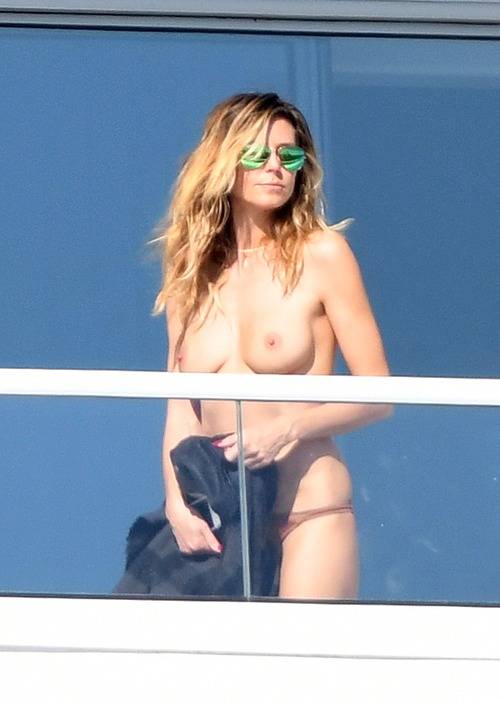 Heidi Klum - topless bikini on a balcony in Miami - 1/7/17