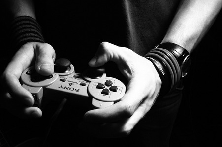 playing_playstation_flickr__cc__s-revenge_4664950_lrg
