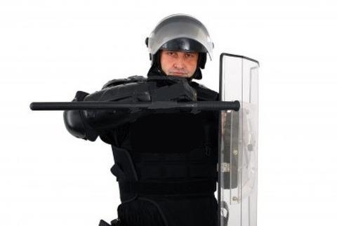 5941230-riot-policeman-defense-pose
