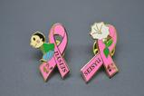 「青洲君」 とマンダラゲの花をデザインしたシンボルバッジ