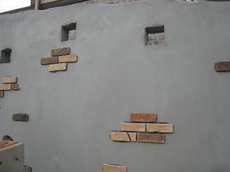 レンガタイル貼り施工中の壁