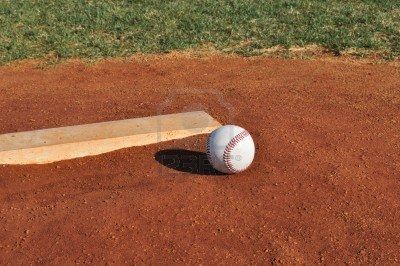 6997671-baseball-on-the-pitcher-s-mound-near-the-pitching-rubber