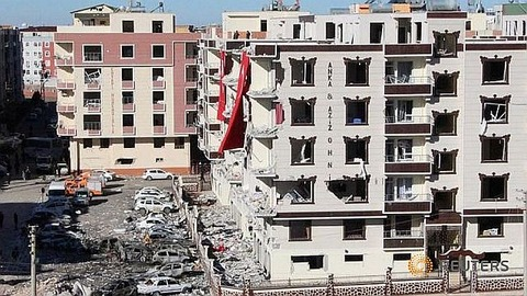 damaged-cars-and-buildings-are-seen-after-friday-s-explosion