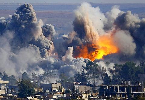 US air strike on an IS-held city, file, 2015