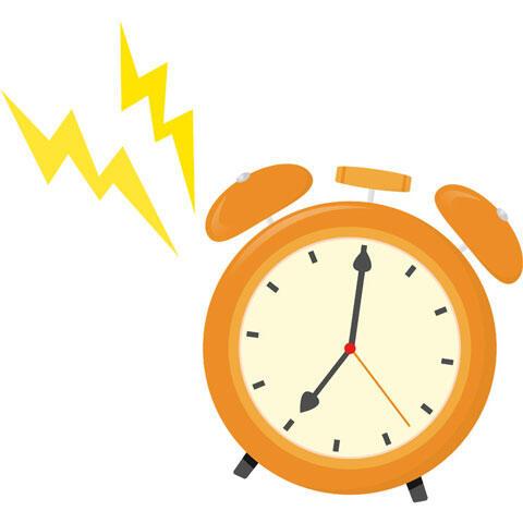 鳴っている目覚まし時計