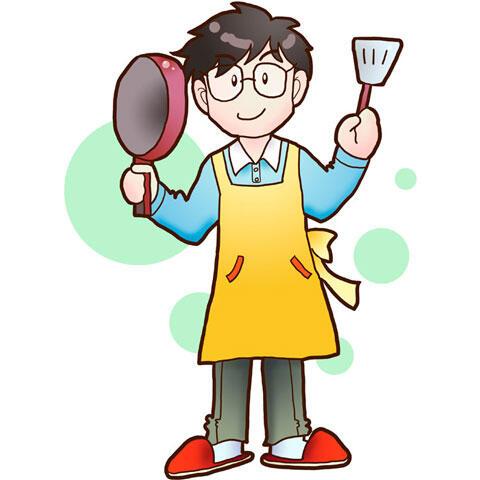 フライパンとフライ返しを持って料理を作るパパ