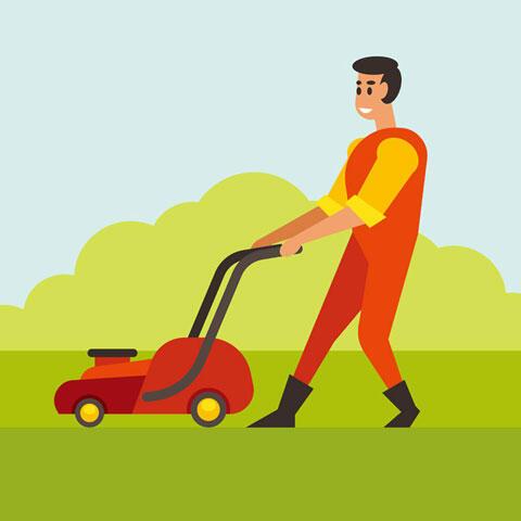 芝刈機を使う男性