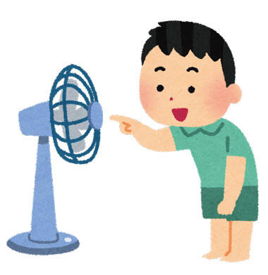 扇風機に指を入れようとしている子供