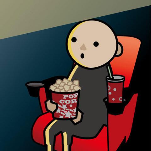 映画館で映画を見ている観客