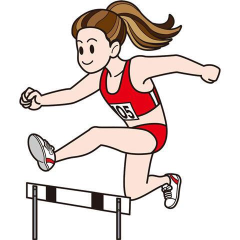 ハードルを跳ぶ女子陸上選手