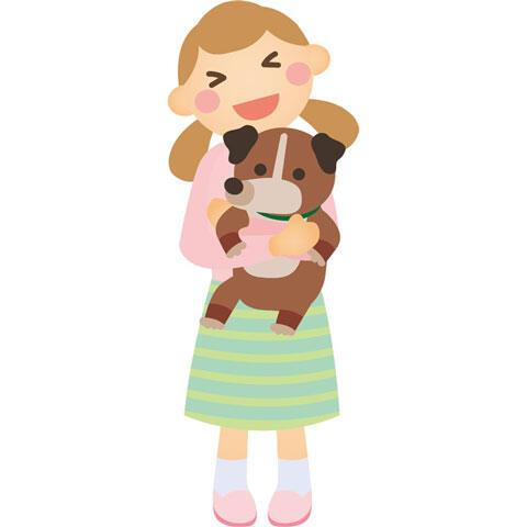 犬を抱える女の子