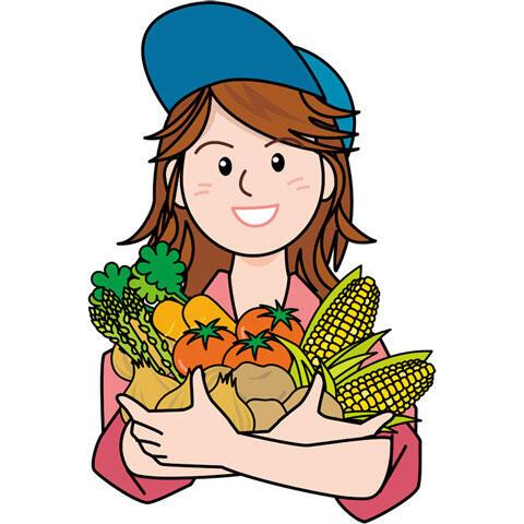 収穫した野菜を抱える農家の女性