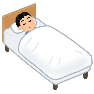 ベッドで寝る人