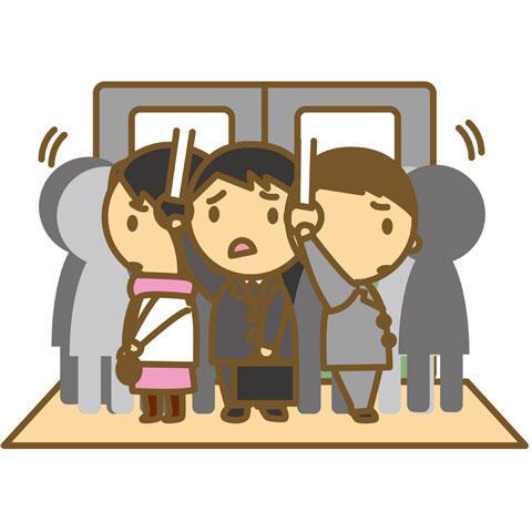 満員電車で通勤通学する人々