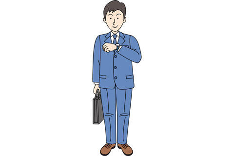 腕時計で時間を確認する男性会社員