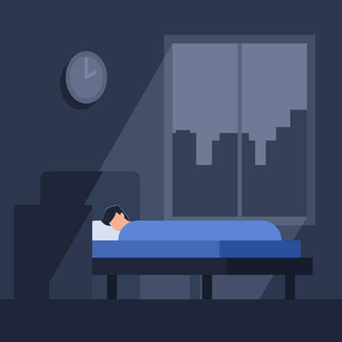 寝込む男性