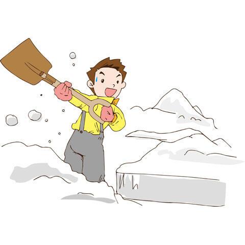 雪掻きする男性