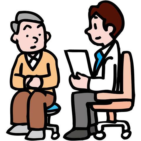 患者を診察する男性医師