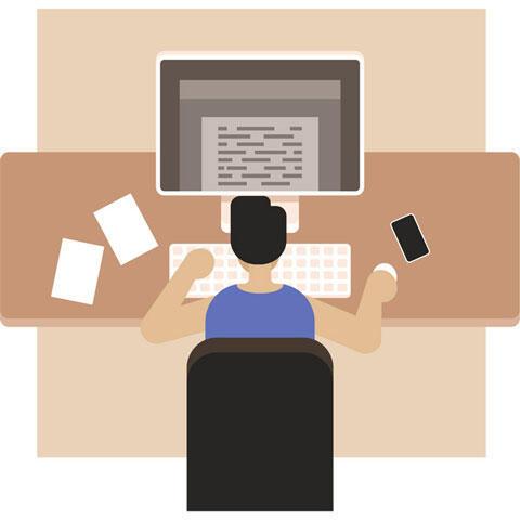 パソコンを使って働くプログラマー
