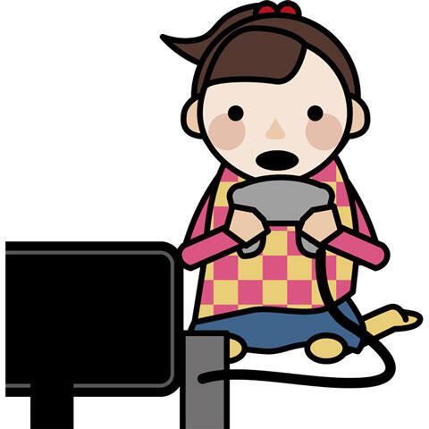 テレビゲームに夢中の女の子