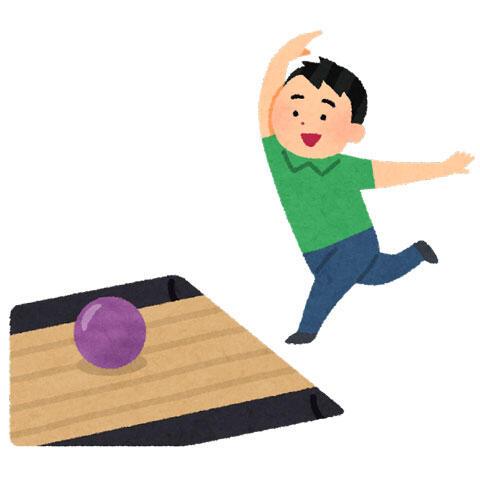 ボウリングのボールをレーンに投げる人
