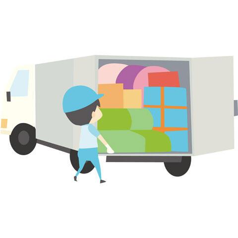 トラックに荷物を積む引っ越し業者