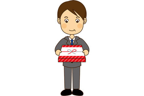 贈り物を持って挨拶するサラリーマン男性