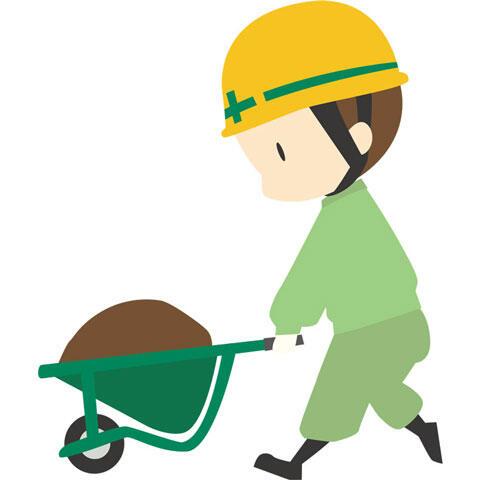 工事用一輪車で土を運ぶ建設作業員