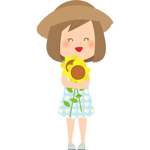 摘んだ向日葵を抱える女の子