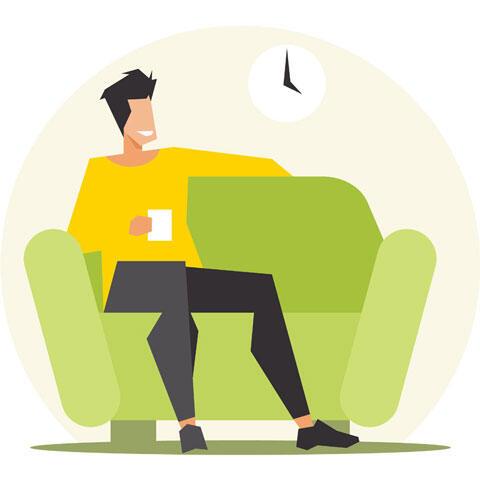 ソファーに座ってくつろぐ男性