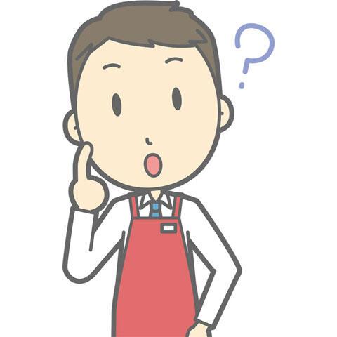 疑問の表情を浮かべるスーパーの男性店員