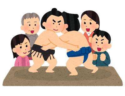 相撲を観戦する人たち