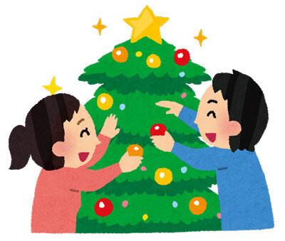 クリスマスツリーの飾り付けをしている人