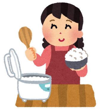 ご飯を山盛りよそっているお母さん