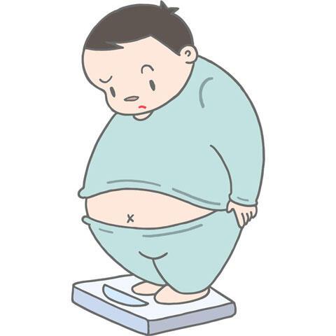 体重計に乗る肥満男性