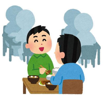 食堂で美味しそうにご飯を食べている人たち