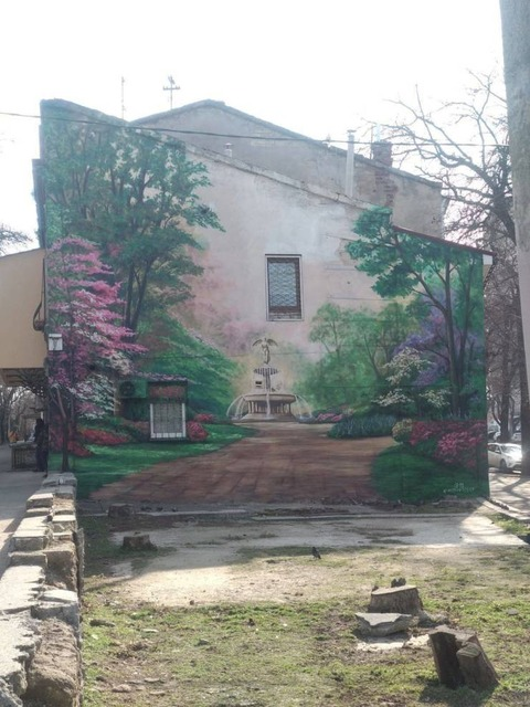 奥行きがある家の壁画