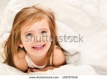 stock-photo-adorable-little-girl-awaked-up-in-her-bed-128767049