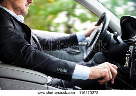 stock-photo-man-driving-his-car-116279278