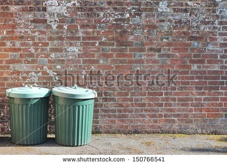 stock-photo-dustbins-outside-against-brick-wall-150766541