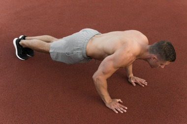 athletic-man-doing-push-ups_23-2148605686