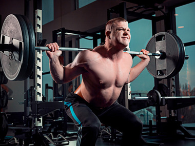 attractive-man-works-out-with-dumbbells-in-gym_155003-2495