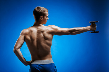 fit-young-man-with-beautiful-torso-on-blue_155003-5532