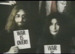 john&yoko with postcard