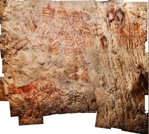 野生の牛とみられる動物(左下)が描かれたインドネシアの洞窟壁画