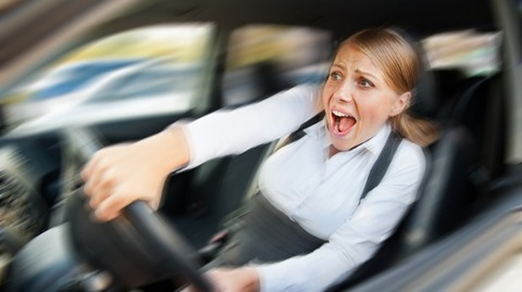 Frightened-driver-reacts-in-alarm-via-Shutterstock-615x345